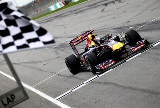 Vettel fait le hat trick !