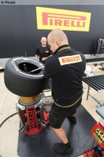 Photo P Zero white medium tyre being mounted on a rim-1024.jpg