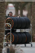 Photo Orange hard tyres being wheeled in the paddock-1024.jpg