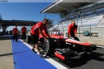 Photo Marussia mechanics are pushing the car in the pit lane-1024.jpg